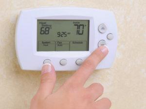 closeup of a womans hand setti 28959878 300x225 - Heat Pump Service