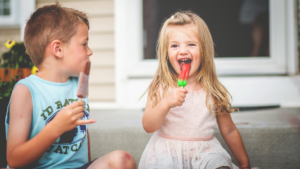 Kids With Popsicles on Stoop 300x169 - Blog